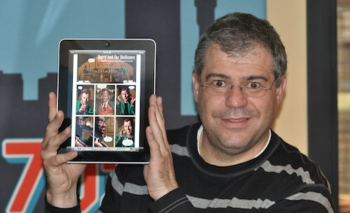 Talk Radio 702's Aki Anastasiou showing off the Apple iPad