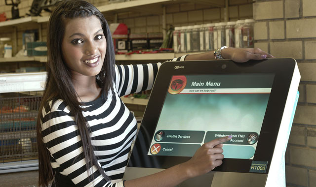 A model demonstrates a Slimline ATM installed at a hardware retailer in Midrand, near Johannesburg (image supplied)