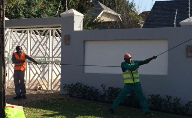 Workers extending fibre in a Johannesburg suburb