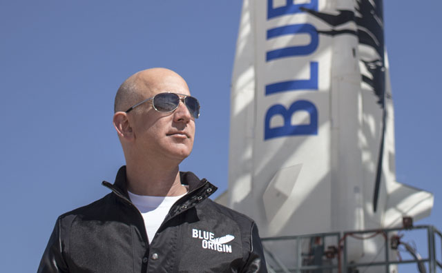 Jeff Bezos in front of a Blue Origin rocket. Image: Blue Origin