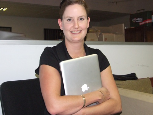 Samantha Perry shows off her shiny new MacBook Pro